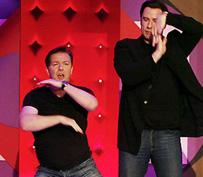 Extras Ricky Gervais and John Travolta