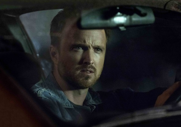 Aaron Paul as Eddie Lane, a convert to Meyerism suffering a crisis of faith.  Credit: Greg Lewis/Hulu