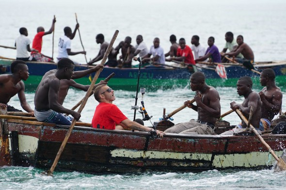 Always up for an adventure, Dominic Monaghan joins an adrenaline-fueled rowboat race during Vilanculos' fishing festival.