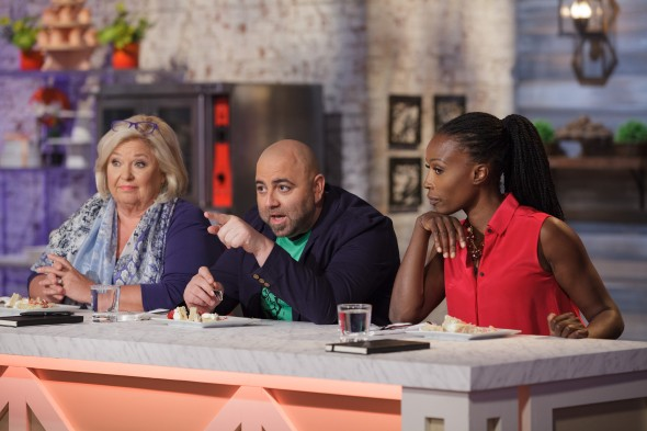 "Judge Duff Goldman, center, comments on a vanilla bean cake prepared by Najie Mercedes during the ""Berry Naked Cake"" main-heat challenge, as seen on Food Network's Spring Baking Championship, Season 2."
