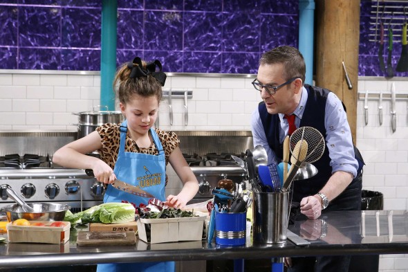 Host Ted Allen checks in on a junior chef on Food Network's Chopped Junior
